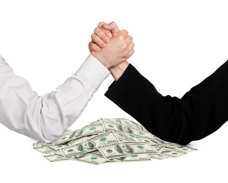 Two wrestling hands and money isolated on white background