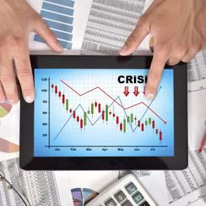 hands holding digital tablet with crisis chart on screen