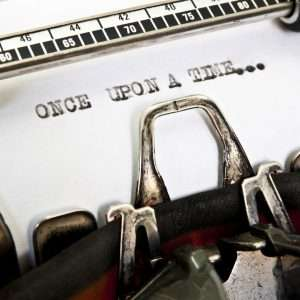 The words 'Once Upon A Time...' picked out on a grungy old typewriter.